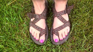 Sandal feet in grass