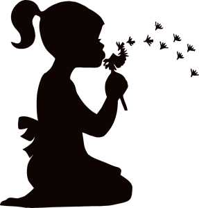 Girl silhouette with dandelion seeds blowing